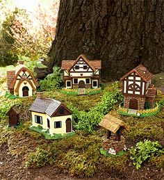 fairy houses could be made from christmas village houses