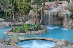 Go All Natural Modern with Waterfall Pool: A Hot Tub And Waterfall Feature Add To The Granduer Of Your Backyard Pool