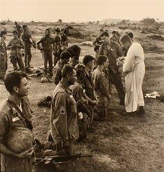 US soldiers receiving communion in Vietnam