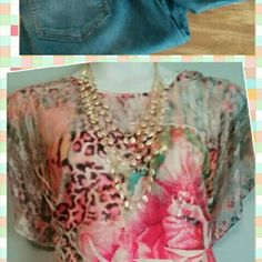 Trendy top This top has all of this year's trends in one shirt. Florals, lace, animal print, and peplum. A real eye catcher that is so slimming. Tops Blouses
