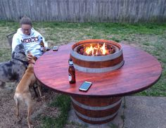Enjoy a wine barrel table with friends or family on these cold Winter nights.