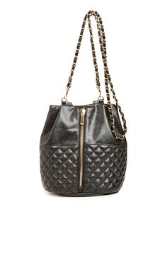 Head back to school in style by carrying our stylish Convertible Quilted Bucket Bag. This faux leather bag converts to a backpack, shoulder bad, or tote, and features a front zipper closure and full lining. <b>Stylist Tip</b>: Carry this attention getter to class or to a lunch date with the girls.