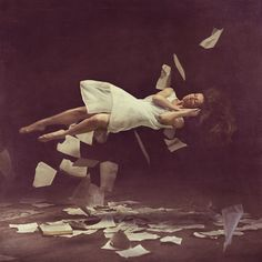 I've been wanting to do a shoot with ripped up pieces of paper flying in the frame.