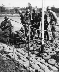 French engineers inspect the German anti-tank mines Teller (Tellermine 35 Stahl), taken on the Siegfried Line. Read more: http://histomil.com/viewtopic.php?f=338&t=3918&sid=3956750bf550459aba1341c2d60f4481&start=4730#ixzz3VhGy0Bl6
