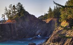 Sleep at one of 37 sites beneath an old-growth forest of spruce, fir, and hemlock on this rugged section of Oregon coastline.