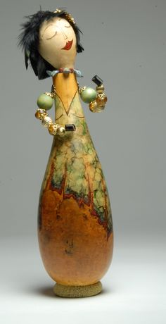 France Benoit Lady of fortune made with recycled jewelry Gourd made by France Benoit Photo by Bruno Gallant