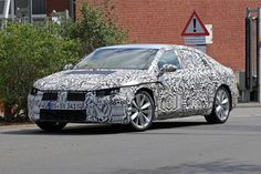 2017 VW CC coupe spotted with new curvaceous design