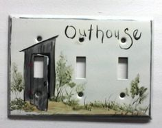 Hand painted metal triple light switch cover with an outhouse