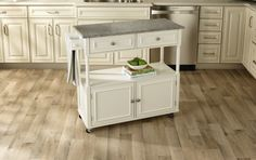 Sandra Lee Kitchen Island Cart - Granite Top A 40 1/4 inches wide, 15 3/4 inches deep and 35 3/4 inches high @ Amazon.com $164.93