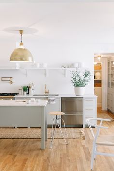 White kitchen, open shelving, kitchen island. Design+styling by @pencilpco. @schoolhouseelec hardware. Circa Lighting. Photo: Leslee Mitchell.