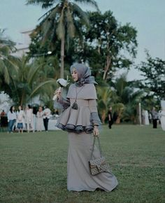 Image may contain: 1 person Hijab Gown, Kebaya Hijab, Hijab Evening Dress, Hijab Dress Party, Kebaya Dress, Kebaya Brokat, Dress Brokat Muslim, Kebaya Muslim, Muslim Dress