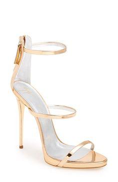 Free shipping and returns on Giuseppe Zanotti'Coline' Sandal (Women) at Nordstrom.com. A gleaming metallic finish illuminates the modern, minimalist silhouette of a three-strap sandal set on a slender stiletto heel.