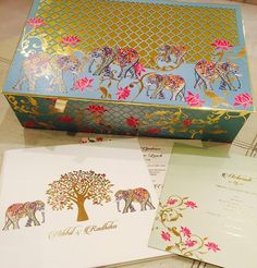 So much pretty !!!! The colours  the elephant motifs and the elegance of it all ! By @houseofdesignnewdelhi | Find your invitation designer on WedMeGood | #weddingcard #invitations #indianbride #indanwedding #indianweddingcard #weddinginvites #wedvites #elephants #elegant #white #gold