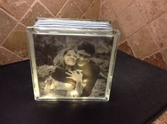 SPECIAL ORDER GLASS LIGHT BLOCK WITH VELLUM PICTURE, NAVY STRIPED RIBBON EMBELLISHMENT AND WARM LED BATTERY OPERATED LIGHTS.  [Perfect idea for engagement, wedding, anniversary, and baby shower gift].  Please inquire with a personal message for further details!