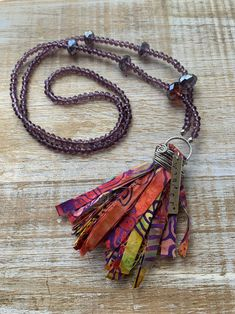 Not all those who wander are lost. Excited to share the latest addition to my shop: One of a Kind Handmade Purple Crystal Tassel Handstamped Wander Necklace Ribbon Jewelry, Wire Jewelry, Boho Jewelry, Jewelry Crafts, Jewelry Design, Textile Jewelry, Fabric Jewelry, Fabric Beads, Fabric Necklace