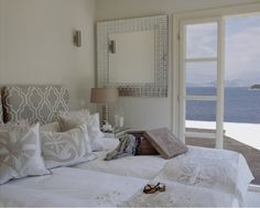 Love the pattern headboard, color scheme and view!