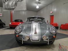 1962 Porsche 356Sunroof Coupe Outlaw Proudly offered For Sale by Porsche of Omaha  Beautiful Laguna Green metallic with Silver metallic racing stripes You truly must see this car in person to appreciate the level of workmanship & custom fabrication!Call (402) 592-1000 ask for Mitch Schneringer. Porsche Sales ManagerThis is an award winning show car. that drives amazing due to modern tech