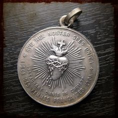 Beautiful antique radiant heart medal