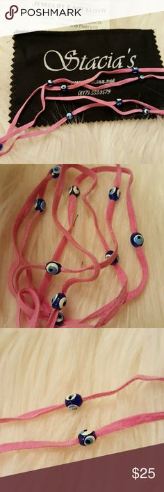 VTG PINK LEATHER EVIL EYE WRAP BRACELET Purchased this a Greek Festival! Has 11 greek evil little eyes handpainted by artisan. Cute as a wrap bracelet or tie as a necklace. NEVER WORN. COMES WITH ORIGINAL PACKAGING SILVER POLISH CLOTH!! Vintage Jewelry Bracelets