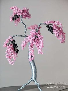 Dont like the trunk or wire color too much but the beads remind me of a cherry blossom tree :) Bonsai Trees For Sale, Bonsai Tree Care, Wire Crafts, Bead Crafts, Nifty Crafts, Jewelry Tree, Wire Jewelry, Wire Earrings, Beaded Jewelry