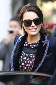 Margot Robbie worked her new brown hair while out and about in Paris.