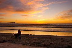 "cazadordementes: ""EL MÉXICO DE LOS MEXICANOS ""Seller at sunset."" A seller and his dog walking on the beach at sunset."