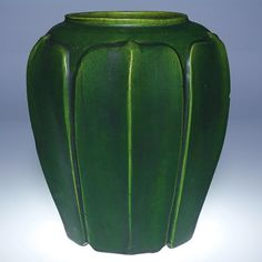 """Cambridge Art Pottery 10 inch oil lamp base, made in the Otoe line from 1907 until 1908 to resemble Grueby Pottery with its organic forms and deep mat green glazes. Marked with the CAP """"Acorn"""" symbol."""