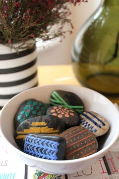 Aztec-inspired painted rocks