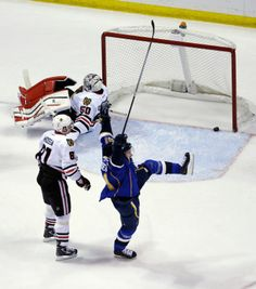 Vladimir Tarasenko celebrates after scoring past Chicago Blackhawks goalie Corey Crawford during the first period in Game 1 of a first-round NHL hockey Stanley Cup playoff series. Blues won the game 4-3 in triple OT. 4-17-14