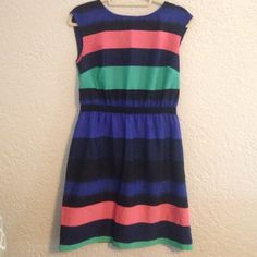 Loft striped dress Perfect for many occasions! This pink, green, blue, and black striped dress is great for the spring and summer! It is very comfortable and flattering with a black elastic non-removable, non-adjustable waist/belt. Easy to launder. Comes about 4 inches above my knee. Dress is lined. Fits size 4/6 LOFT Dresses