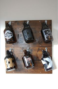 DIY Growler Wall   We needed a way to organize our growlers as they were taking up valuable kitchen space!  This DIY only took an hour total and it cost under $20. Check out the blog for the step by step tutorial.