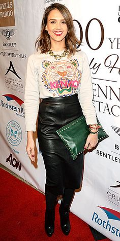 Last Night's Look: Love It or Leave It? | JESSICA ALBA | She is woman, hear her sweatshirt roar. The actress teams a tiger-emblazoned Kenzo (did you really need us to tell you the brand?) top with a leather pencil skirt and forest-green Valentino clutch at the Experience: East Meets West event in Beverly Hills.