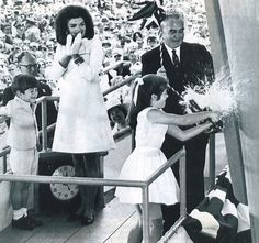 May 1967 launch: A nine-year-old Caroline Kennedy, watched by her mother Jacqueline and brother John Jr, christens the original USS John F Kennedy aircraft carrier.