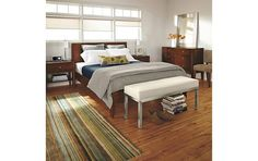 I like this for a guest room. Clean lines, warmed by wood and color in rug.