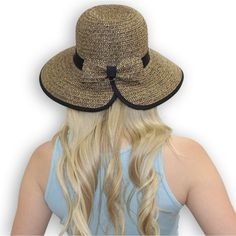 Great summer multi-use UPF 50 sun hat. Sun protective and stylish with a lightweight summer fabric enhanced with a contrasting ribbon band that wraps the crown.