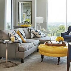 Gray Couch With Blue And Yellow Accents