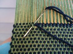 hem stitching needle insertion, top of piece