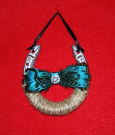 Decorated Horse Shoe with Turquoise Feather