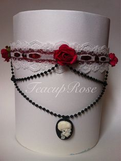 Red and white lace chocker necklace with roses black pearls rhinestones and skull cameo