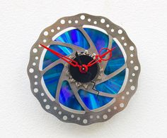 Clock made from a recycled Bike brake Disk by pixelthis on Etsy
