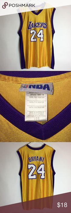 Men's NBA Kobe Bryant Los Angeles Lakers Jersey ITEM DESCRIPTION Brand: NBA Item name: Men's Kobe Los Angeles Lakers Jersey   Color: Gold Condition:This is a pre-owned item. They are in excellent used condition with no stains, rips, holes, etc. THERE ARE SOME SNAGS ON FRONTComes from a smoke free household. Size: Large Measurements PIT TO PIT 22 - inches nba Shirts Tank Tops