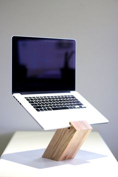 Avoid the laptop hunch with the GreaterUp laptop stand. The minimalist, solid wood stand is designed to elevate your laptops screen to eye level to