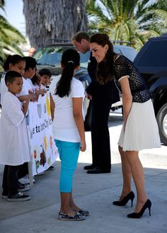 Sneh Chachra a student of Inner City Arts greets Catherine, Duchess of Cambridge after she arrived with her husband Prince William, Duke of Cambridge, for a tour of the school on July 10, 2011 in the Skid Row section of Los Angeles, California.