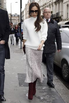 Victoria Beckham's London street-style includes chunky white turtle-necks and long textured skirts.