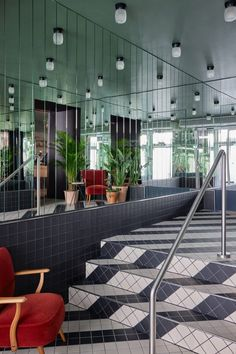 The walls of the hotel lobby are finished with mirrored panels. Georgian Terrace, Hexagon Mosaic Tile, Mirror Room, Off White Walls, Walter Gropius, Architrave, Floor Patterns, Wooden Stairs, Hotel Interiors
