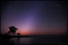 """Quandrantid Meteors and Zodiac Lights over the Florida Keys 2 - Astrophotographer Jeff Berkes took this photo Jan. 4, 2012, and said: """"I captured at least a dozen meteors and counted about 100. This year was certainly better than last year. The Zodiac Lights could been seen for a good hour before dawn started as seen on the one side of the photo."""""""