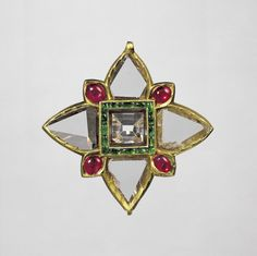 Pendant fabricated from gold in kundan technique and set with natural unpolished flat diamonds surrounding a central cut and polished diamond, with cabochon rubies and emeralds. North India or Deccan, early 11th century