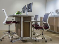 Nurse's Station by Carolina shown with Flexxy Stool and Swivel by OFS. #healthcare