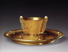 Pearl encrusted solid gold 'dragon' cup and saucer, Qing Dynasty, Forbidden City Palace Museum collection. Overall Height: 7.3cm; Cup circumference: 7.1cm; Saucer Height: 2.2cm; Saucer Height: circumference: 18cm.