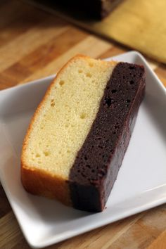 Brownie butter cake - thick brownie and rich butter cake combined into one decadent and to-die-for cake! Bake the brownie first and then the butter cake | rasamalaysia.com. This reminds me of the brownie/Madeline combo that our local grocery store sells.